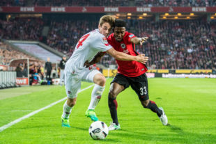 COLOGNE, GERMANY - APRIL 04: Lukas Kluenter (L) of Koeln and Taleb Tawatha (R) of Frankfurt in action during the Bundesliga match between 1. FC Koeln and Eintracht Frankfurt at RheinEnergieStadion on April 4, 2017 in Cologne, Germany.