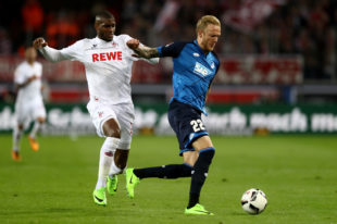 COLOGNE, GERMANY - APRIL 21: Anthony Modeste (L) of Koeln and Kevin Vogt of Hoffenheim battle for the ball during the Bundesliga match between 1. FC Koeln and TSG 1899 Hoffenheim at RheinEnergieStadion on April 21, 2017 i