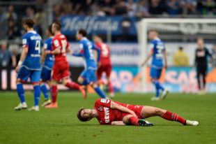 SINSHEIM, BADEN-WUERTTEMBERG - APRIL 03: Lukas Kluenter of 1. FC Koeln lies on the pitch during the Bundesliga match between 1899 Hoffenheim and 1. FC Koeln at Wirsol Rhein-Neckar-Arena on April 3, 2016 in Sinsheim, Germany.