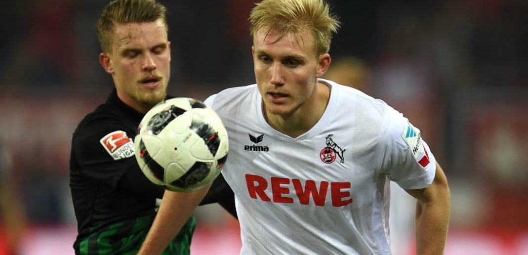 Cologne's Danish defender Frederik Soerensen and Augsburg´s defender Philipp Max vie for the ball during the German first division Bundesliga football match of 1 FC Cologne vs FC Augsburg in Cologne, western Germany, on November 26, 2016. / AFP / PATRIK STOLLARZ / RESTRICTIONS: DURING MATCH TIME: DFL RULES TO LIMIT THE ONLINE USAGE TO 15 PICTURES PER MATCH AND FORBID IMAGE SEQUENCES TO SIMULATE VIDEO. == RESTRICTED TO EDITORIAL USE == FOR FURTHER QUERIES PLEASE CONTACT DFL DIRECTLY AT + 49 69 650050 (Photo credit should read