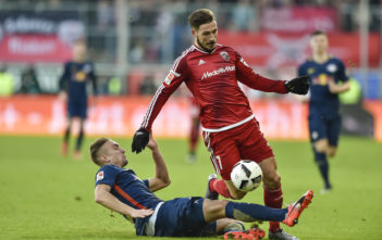 Leipzig's Austrian midfielder Stefan Ilsanker (L) fouls Ingolstadt's Australian forward Mathew Leckie during the German first division Bundesliga football match between Ingolstadt and Leipzig in Ingolstadt, southern Germany, on December 10, 2016. Leipzig's Austrian midfielder Stefan Ilsanker fouls Ingolstadt's Australian striker Mathew Leckie during the German first division Bundesliga football match FC Ingolstadt 04 vs RB Leipzig in the southern German city of Ingolstadt on December 10, 2016.