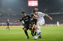 COLOGNE, GERMANY - DECEMBER 21: Wendell (L-R), Admir Mehmedi of Leverkusen and Dominique Heintz of Koeln fight for the ball during the Bundesliga match between 1. FC Koeln and Bayer 04 Leverkusen at RheinEnergieStadion on December 21, 2016 in Cologne, Germany.