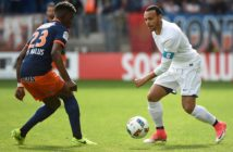 Toulouse's Danish forward Martin Braithwaite (R) vies with Montpellier's French defender Nordi Mukiele (L) during the French L1 football match between Montpellier (MHSC) and Toulouse (TFC) at the Mosson stadium in Montpellier, on April 2, 2017.