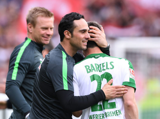 FREIBURG GERMANY - APRIL 1: (L) Headcoach Alexander Nouri and Fin Bartels of Werder Bremen celebrating after the Bundesliga match between Sport Club Freiburg and Werder Bremen at Schwarzwald-Stadion on April 1, 2017 in Freiburg, Germany.