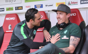 FREIBURG GERMANY - APRIL 1: (L) Headcoach of Werder Bremen Alexander Nouri talks to Max Kruse before the Bundesliga match between Sport Club Freiburg and Werder Bremen at Schwarzwald-Stadion on April 1, 2017 in Freiburg, Germany.