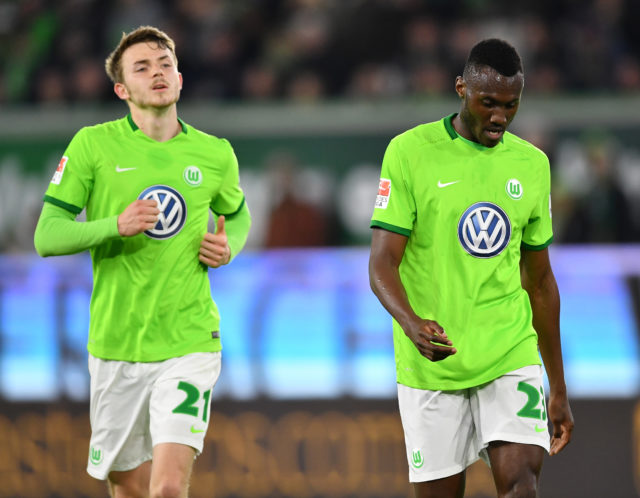 WOLFSBURG, GERMANY - APRIL 05: Jannes Horn and Josuha Guilavogui of Wolfsburg look dejected during the Bundesliga match between VfL Wolfsburg and SC Freiburg at Volkswagen Arena on April 5, 2017 in Wolfsburg, Germany.