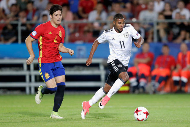 KRAKOW, POLAND - JUNE 30: Serge Gnabry of Germany gets away from Jorge Mere of Spain during the UEFA European Under-21 Championship Final between Germany and Spain at Krakow Stadium on June 30, 2017 in Krakow, Poland.