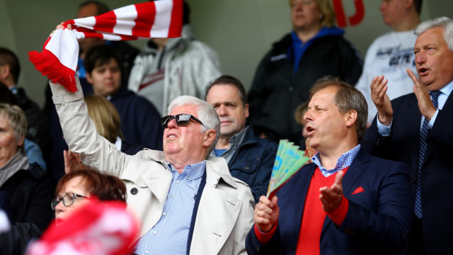 COLOGNE, GERMANY - MAY 25: President Werner Spinner and vice-president Markus Ritterbach of Koeln sing the anthem prior to the Women's 2nd Bundesliga match between 1. FC Koeln and Bayern Muenchen II at Franz-Kremer Stadium on May 25, 2015 in Cologne, Germany. (Photo by Christof Koepsel/Bongarts/Getty Images)
