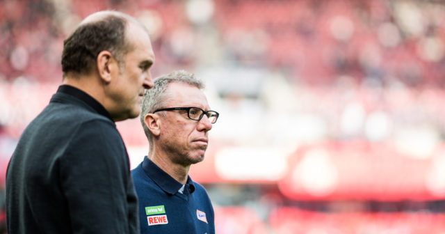 COLOGNE, GERMANY - OCTOBER 15: Manager of Koel Joerg Schmadtke (L) and Head Coach Peter Stoeger stay together prior to the Bundesliga match between 1. FC Koeln and FC Ingolstadt 04 at RheinEnergieStadion on October 15, 2016 in Cologne, Germany. (Photo by Lukas Schulze/Bongarts/Getty Images)