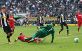 MOENCHENGLADBACH, GERMANY - AUGUST 20: Nico Elvedi of Moenchengladbach (left) scores his teams first goal past goalkeeper Timo Horn of Koeln during the Bundesliga match between Borussia Moenchengladbach and 1. FC Koeln at Borussia-Park on August 20, 2017 in Moenchengladbach, Germany. (Photo by Christof Koepsel/Bongarts/Getty Images)