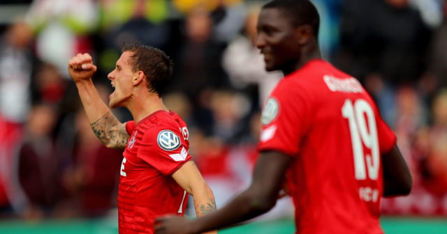 BREMERHAVEN, GERMANY - AUGUST 12: Simon Zoller (L) of Koeln celebrates after he scores the 5th goal during the DFB Cup first round match between Leher TS and 1. FC Koeln at Nordseestadion on August 12, 2017 in Bremerhaven, Germany. (Photo by Martin Rose/Bongarts/Getty Images)