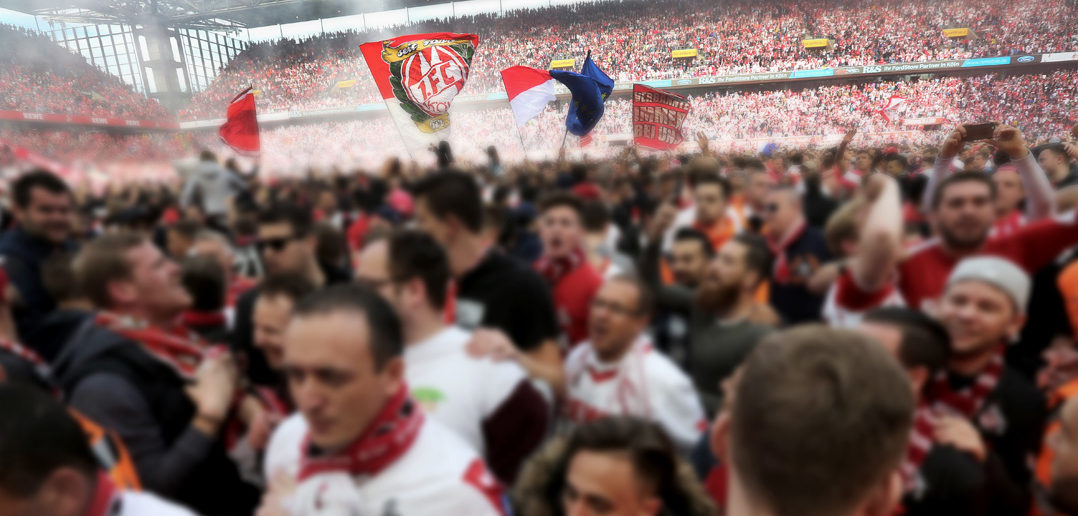 COLOGNE, GERMANY - MAY 20: Supporters of Cologne celebrate after the 2-0 win against 1. FSV Mainz 05 at RheinEnergieStadion on May 20, 2017 in Cologne, Germany. Cologne will play Europe League next season. (Photo by Juergen Schwarz/Bongarts/Getty Images)