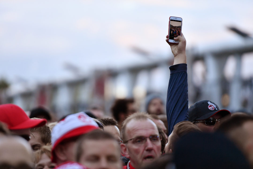 LONDON, ENGLAND - SEPTEMBER 14: An FC Koeln fan takes a picture of his fellow supporters as they are held outside the stadium by police prior to the UEFA Europa League group H match between Arsenal FC and 1. FC Koeln at Emirates Stadium on September 14, 2017 in London, United Kingdom. (Photo by Dan Mullan/Getty Images)