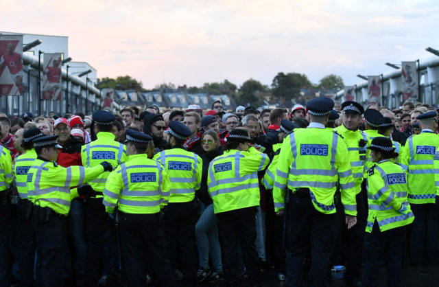 LONDON, ENGLAND - SEPTEMBER 14: FC Koeln fans are held by police ahead of arriving at the Emirates Stadium prior to the UEFA Europa League group H match between Arsenal FC and 1. FC Koeln at Emirates Stadium on September 14, 2017 in London, United Kingdom. (Photo by Dan Mullan/Getty Images)