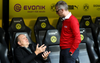 DORTMUND, GERMANY - SEPTEMBER 17: Peter Stoeger (R), head coach of Koeln talks to sport director Joerg Schmadtke before the Bundesliga match between Borussia Dortmund and 1. FC Koeln at Signal Iduna Park on September 17, 2017 in Dortmund, Germany. (Photo by Martin Rose/Bongarts/Getty Images)