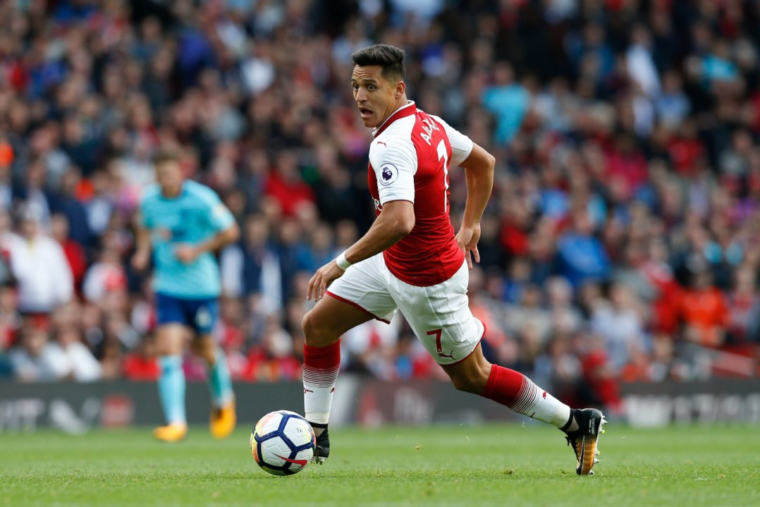Arsenal's Chilean striker Alexis Sanchez runs with the ball during the English Premier League football match between Arsenal and Bournemouth at the Emirates Stadium in London on September 9, 2017. / AFP PHOTO / Ian KINGTON / RESTRICTED TO EDITORIAL USE. No use with unauthorized audio, video, data, fixture lists, club/league logos or 'live' services. Online in-match use limited to 75 images, no video emulation. No use in betting, games or single club/league/player publications. / (Photo credit should read IAN KINGTON/AFP/Getty Images)