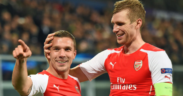 Arsenal's Polish-born German striker Lukas Podolski (L) celebrates with Arsenal's German defender Per Mertesacker after scoring during a UEFA Champions League group stage football match Anderlecht vs Arsenal at the Constant Vanden Stock stadium in Anderlecht on October 22, 2014. AFP PHOTO / EMMANUEL DUNAND (Photo credit should read EMMANUEL DUNAND/AFP/Getty Images)