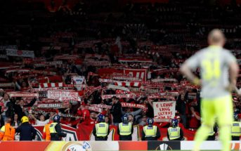 Cologne's supporters raise their scarves in the crowd during the UEFA Europa League Group H football match between Arsenal and FC Cologne at The Emirates Stadium in London on September 14, 2017. / AFP PHOTO / Adrian DENNIS (Photo credit should read ADRIAN DENNIS/AFP/Getty Images)
