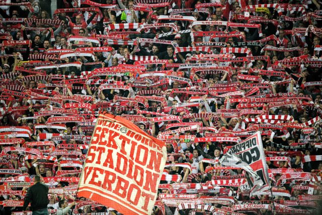 Cologne's supporters cheer their team during the German first division Bundesliga football match Borussia Dortmund v FC Cologne in Dortmund, western Germany, on September 17, 2017. / AFP PHOTO / SASCHA SCHUERMANN / RESTRICTIONS: DURING MATCH TIME: DFL RULES TO LIMIT THE ONLINE USAGE TO 15 PICTURES PER MATCH AND FORBID IMAGE SEQUENCES TO SIMULATE VIDEO. == RESTRICTED TO EDITORIAL USE == FOR FURTHER QUERIES PLEASE CONTACT DFL DIRECTLY AT + 49 69 650050 (Photo credit should read SASCHA SCHUERMANN/AFP/Getty Images)