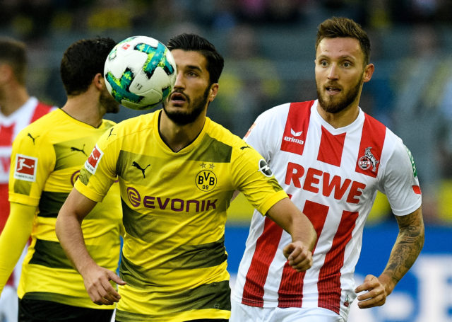 Dortmund's Turkish midfielder Nuri Sahin (L) and Cologne's midfielder Marco Hoeger vie for the ball during the German first division Bundesliga football match Borussia Dortmund v FC Cologne in Dortmund, western Germany, on September 17, 2017. / AFP PHOTO / SASCHA SCHUERMANN / RESTRICTIONS: DURING MATCH TIME: DFL RULES TO LIMIT THE ONLINE USAGE TO 15 PICTURES PER MATCH AND FORBID IMAGE SEQUENCES TO SIMULATE VIDEO. == RESTRICTED TO EDITORIAL USE == FOR FURTHER QUERIES PLEASE CONTACT DFL DIRECTLY AT + 49 69 650050 (Photo credit should read SASCHA SCHUERMANN/AFP/Getty Images)