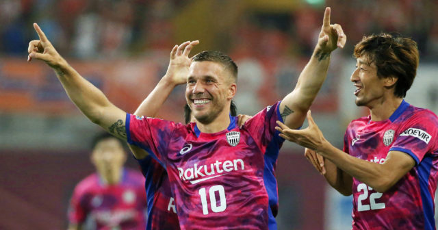 Vissel Kobe's Lukas Podolski of Germany (C) celebrates his first goal with his teammates during his J-League football match against Omiya Ardija in Kobe on July 29, 2017. / AFP PHOTO / JIJI PRESS / STR / Japan OUT (Photo credit should read STR/AFP/Getty Images)