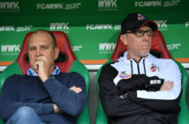 AUGSBURG, GERMANY - SEPTEMBER 09: Joerg Schmadtke, sports director of Koeln (L) and head coach Peter Stoeger of Koeln look in opposite directions during the Bundesliga match between FC Augsburg and 1. FC Koeln at WWK-Arena on September 9, 2017 in Augsburg, Germany. (Photo by Sebastian Widmann/Bongarts/Getty Images)
