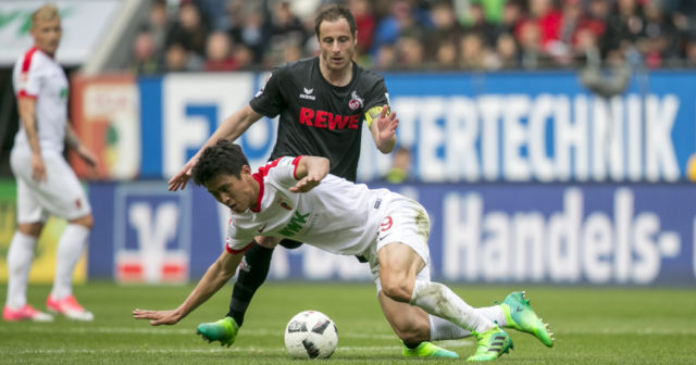AUGSBURG, GERMANY - APRIL 15: Ja-Cheol Koo of FC Augsburg battles for the ball during the Bundesliga match between FC Augsburg and 1. FC Koeln at WWK Arena on April 15, 2017 in Augsburg, Germany. (Photo by Jan Hetfleisch/Bongarts/Getty Images)