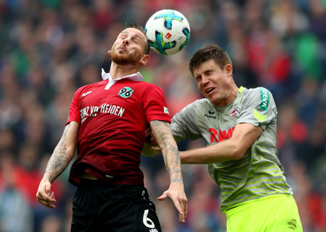 HANOVER, GERMANY - SEPTEMBER 24: Marvin Bakalorz (L) of Hannover and Dominique Heintze of Koeln battle for the ball during the Bundesliga match between Hannover 96 and 1. FC Koeln at HDI-Arena on September 24, 2017 in Hanover, Germany. (Photo by Martin Rose/Bongarts/Getty Images)