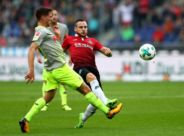 HANOVER, GERMANY - SEPTEMBER 24: Marvin Bakalorz (R) of Hannover and Salih Oezcan of Koeln battle for the ball during the Bundesliga match between Hannover 96 and 1. FC Koeln at HDI-Arena on September 24, 2017 in Hanover, Germany. (Photo by Martin Rose/Bongarts/Getty Images)