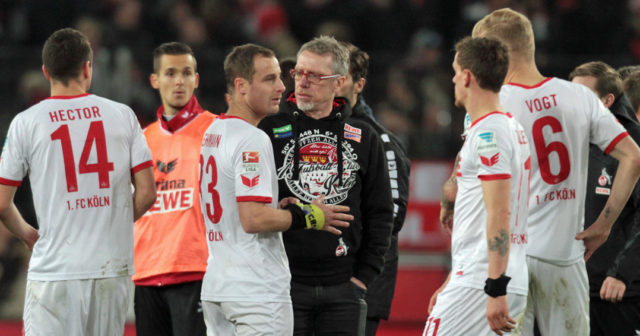 COLOGNE, GERMANY - NOVEMBER 21: Manager Peter Stoeger of Cologne (C) talks to Matthias Lehmann after the Bundesliga match between 1. FC Koeln and 1. FSV Mainz 05 at RheinEnergieStadion on November 21, 2015 in Cologne, Germany. (Photo by Juergen Schwarz/Bongarts/Getty Images)