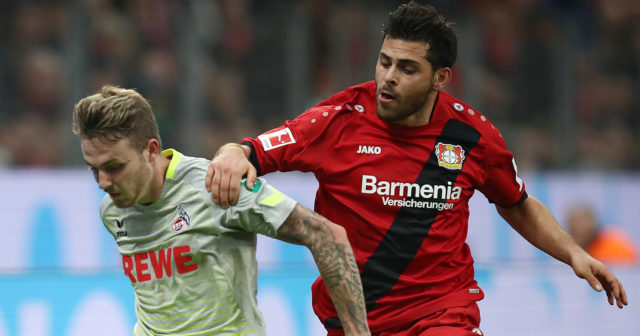 LEVERKUSEN, GERMANY - OCTOBER 28: Kevin Volland of Bayer Leverkusen (r) and Jannes Horn of Koeln fight for the ball during the Bundesliga match between Bayer 04 Leverkusen and 1. FC Koeln at BayArena on October 28, 2017 in Leverkusen, Germany. (Photo by Maja Hitij/Bongarts/Getty Images)