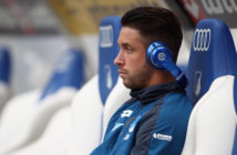 SINSHEIM, GERMANY - SEPTEMBER 09: Mark Uth of Hoffenheim sits on the bench prior to the Bundesliga match between TSG 1899 Hoffenheim and FC Bayern Muenchen at Wirsol Rhein-Neckar-Arena on September 9, 2017 in Sinsheim, Germany. (Photo by Alex Grimm/Bongarts/Getty Images)