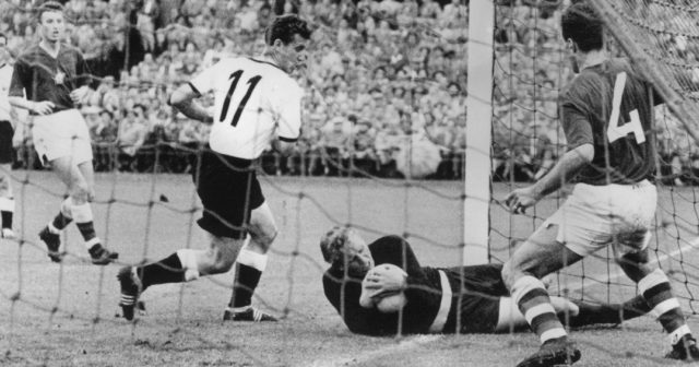 German forward Hans Schaefer shoves the Czech goalkeeper into goal, still holding the ball, during a World Cup match, 13th June 1958. Referee Arthur Ellis allowed the goal, which was hotly disputed by the Czech team. (Photo by Keystone/Hulton Archive/Getty Images)