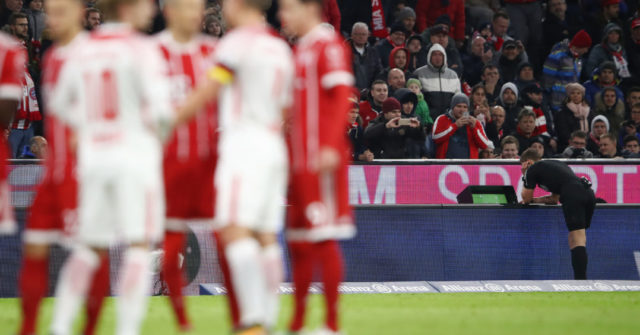 MUNICH, GERMANY - OCTOBER 28: Referee Daniel Siebert looks at the video footage after a foul by Willi Orban of Leipzig (not seen), which results in a red card, during the Bundesliga match between FC Bayern Muenchen and RB Leipzig at Allianz Arena on October 28, 2017 in Munich, Germany. (Photo by Alex Grimm/Bongarts/Getty Images)